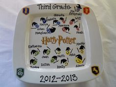 class auction piece- harry potter themed with kids fingerprints, wands and wizard hats designed by Pottery Piazza