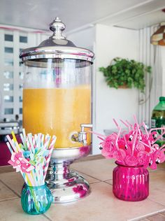 A Fabulous Flamingo First Birthday Pool Party - I'm in love with drinks dispensers!