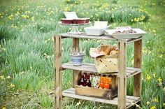 Put your gardeing shed items to good use as your serving station.  Even the shabbiest of shelves can serve a pretty purpose.