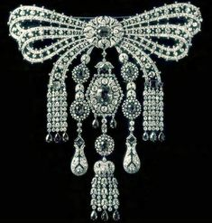 Cartier devant de corsage of sapphires and diamonds presented to Grand Duchess Maria Pavlovna the Younger by her father Grand Duke Paul on her marriage to Prince William of Sweden, present whereabouts unknown. Part of a parure of at least tiara, necklace, and this piece.