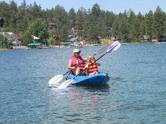 Enjoying family friendly activities such as kayaking on Big Bear Lake, CA.