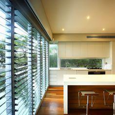 Kitchen With Modern Stools And Jalousie Windows