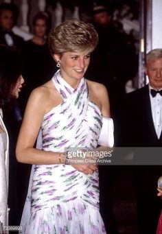 The Princess of Wales attends a banquet at Whitehall, May 1991. She is wearing a Catherine Walker evening gown.