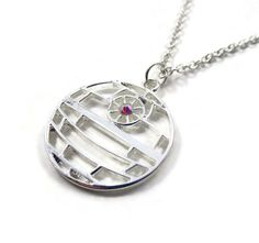 Thats no moon...its a necklace!  This filigree Death Star necklace will knock em dead and leave nothing but a smoking crater behind. Accented with a