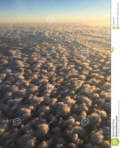 Photo about An aerial image of a far horizon an a sky filled with puffy clouds lit by the morning sun. Image of flying, deep, curve - 109226179 Cloud Lights, Aerial Images, Above The Clouds, Morning Sun, Landscape Paintings, Airplane View, Sunrise, Sky, Heaven