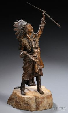 After Carl Kauba (Austrian, 1865-1922) - Bronze of an Indian Chief with a Rifle.