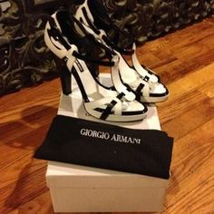 I just discovered this while shopping on Poshmark: REDUCED- Giorgio Armani black and white heels. Check it out! Price: $525 Size: 11, listed by accessoriesgal@carenhelm