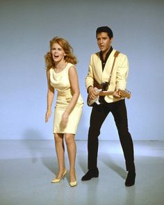 Elvis Presley and Ann-Margret in Viva Las Vegas dances whilst Elvis plays guitar Poster Elvis Presley, Ann Margret Photos, Swedish American, Jackson, Guitar Photos, Old Movie Stars, Cinema Posters, Old Movies, Vintage Hollywood