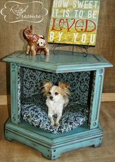 Repurposed an old end table to a dog bed .