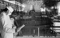 A worker at the Chernobyl nuclear power plant checks the radiation level in the engine room of the first and second power units in this June 5, 1986 photo.