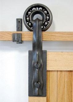 "Lucas House, ""Sliding Barn Door Hardware."" Lucas will teach ""Design/Build/Forge"" in the Penland iron studio May 29-June 10, 2016. More information: http://penland.org/iron/index.html"