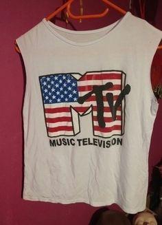 Top MTV!  Kup mój przedmiot na #vintedpl http://www.vinted.pl/damska-odziez/koszulki-na-ramiaczkach-koszulki-bez-rekawow/12743418-wiosenna-wyprzedaz-top-mtv-no-name-m