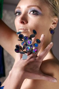 Ring | Poppy Porter.  Anodised (electrically coloured) titanium, photograph, resin