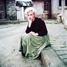 """In May 1954, Milton took Marilyn in the studios of the Fox in the small French village built for """"What price glory has? """"And took a picture. Marilyn wore the costume of Jennifer Jones in """"The Song of Bernadette"""", a tailored jacket, a long skirt, thick black stockings and black shoes. (thanks for sharing """"The films of Marilyn Monroe"""" page on FB)"""