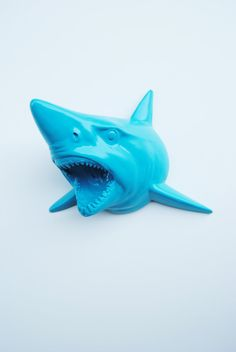 I need this in my office. It's essential.    The Hooper - Blue Raspberry Resin Shark Head- Shark Resin White Faux Taxidermy- Chic & Trendy. $129.99, via Etsy.