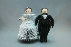 Oh this is cute!!!! This must be a great cake topper! Extremely unique and adorable. Casal de Noivos em origami 3D from elo7.com