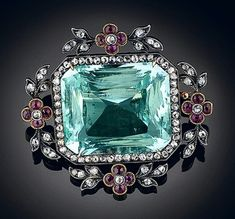 Faberge aquamarine and ruby with diamonds brooch