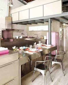 Here is vintage apartment interior design with pink shades in Barcelona. Vintage interior provided with combination of pink colours, classic furniture style and other ornaments. This apartment has open floor plan. It is a two floor apartments. Tile roof and brick walls are used to get more warm feeling of an old fashionable living place. Amazing interior design is applied in this apartment. >>TWO