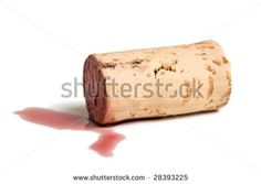 cork lying in puddle of red wine, isolated on white
