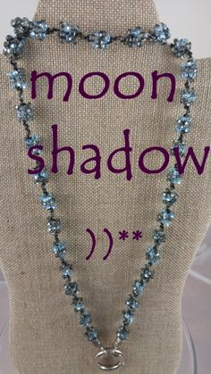MOON SHADOW..$19.99..aqua, smoky blue, black twine. INTERCHANGEABLE JEWELRY CHAINS that becomes a: lanyard, necklace, choker, belt, or eyeglass chain. Includes gift packs with all connector pieces needed.