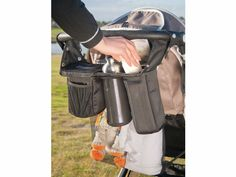 The universal Stroller Caddy from Valco Baby. Includes two large insulated pockets to keep food or drink bottles cool or hot!  #baby #toddler #strollers #strolleraccessories #parenting #valcobaby