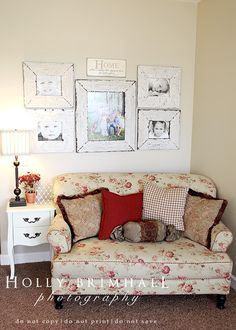 Great idea for the front living room, love the barn wood frames. Sitting area in office with family pictures for display.