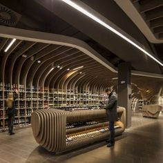 Spar supermarket displays groceries  between curved wooden ribs