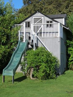 Playhouse - up top playhouse, underneath a lawnmower/pool storage shed & a fully functioning outside bathroom Backyard Buildings, Backyard Sheds, Garden Sheds, Shed Playhouse, Playhouse Ideas, Wooden Playhouse, Outdoor Landscaping, Outdoor Gardens, Outdoor Play Structures