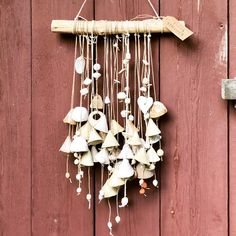 Blij om dit item uit mijn shop te delen: Artisan Ceramic Wallhanging with 28 handmade unique bells and several beads, hanging down from a branch. Ceramic Art, Wind Chimes, Nars, Artisan, Wall Decor, Etsy Shop, Ceramics, Outdoor Decor, Artwork