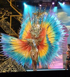 "Miss Trinidad and Tobago Universe 2005/Magdalene Walcott. The National Costume was called ""The Spirit of Trinidad & Tobago, The rainbow that is real"" This costume was worn by National Junior Carnival 2005 Queen, Anna Marie Lee."