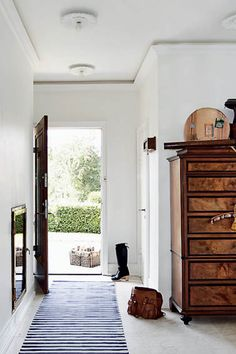 love the armoire/dresser so close to the entry way