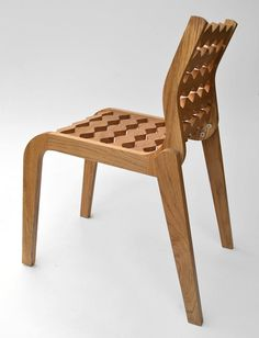 Spain-based Carlos Ortega Design utilizes CNC technology to achieve the look of the stackable outdoor chair called Gap.