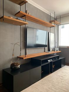 Look at this suspended bookcase with demolition pink peroba wood and bar . Modern Interior Design, Interior Design Living Room, Living Room Designs, Small Living Rooms, Home Living Room, Tv Rack Design, Modern Industrial Decor, Home Tv, House Rooms
