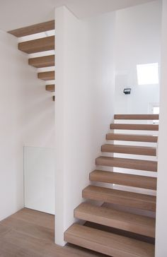 The staircase begins as a closed-riser plastic solid, but notionally pulls apart into stacked open risers as it winds its way up the building. Narrow Staircase, Open Stairs, Modern Staircase, Staircase Design, Spiral Staircase, Stairs Treads And Risers, Staircase Railings, Staircases