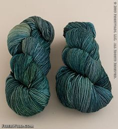 """Malabrigo Yarn's """"Arroyo"""" is a hand dyed, incredibly soft, superwash yarn. Dyed in both tonals and variegated colors, this DK weight yarn is great for finer gauge projects. Think children's garments and light weight sweaters! Dk Weight Yarn, Yarns, Green Colors, Merino Wool, Ravelry, Tutorials, Socks, Throw Pillows, Pure Products"""