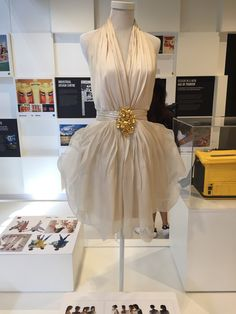 This dress was inspire by the Cattleya orchid. Principle of Design: Dominance, the gold accent in the middle of the dress catches the viewers eyes as the dress itself it white, allowing the gold detail to easily stand out.