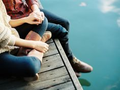 engaged-couple-sitting-on-a-dock-fall
