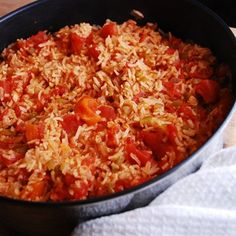 The perfect accompaniment to your favorite Mexican food entrée, this low calorie Spanish rice recipe is not only Weight Watchers friendly, it's delicious, healthy and loaded with fiber and protein.