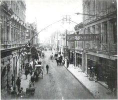 Commerce St. looking east from Main Plaza in the early 1900's. Frank Bros. dept store is on the right. The curved piping over the street is lighting.