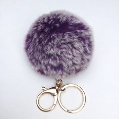 A personal favorite from my Etsy shop https://www.etsy.com/listing/244345086/new-purple-frosted-fur-pom-pom-keychain