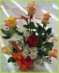 Red roses and yellow roses,daisies,fillers and more in medium vase with floral foam. perfect gift for a birthday and any occasion.