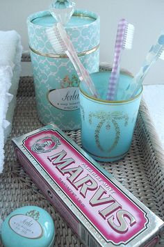 Design LOVE overload! From the turquoise and gold product vintage design to the similar cup design to even the pink and grey vintage toothpaste box! Love it all! This image hits the jackpot was designs I love.