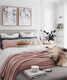 Amazing bedroom design with abstract wall art, white walls and grey bed
