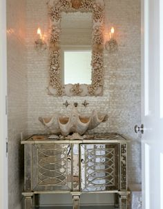 Beach Cottage Decor - Beach House Bath - a mirrored vanity from Island Home, a giant clamshell sink, and a shell mirror are at home with Mother of Pearl tiles by Maya Romanoff. Description from pinterest.com. I searched for this on bing.com/images