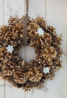 Love the brown w white polka-dot ribbon for an autumn door hanging pinecones!!   Gypsy Purple home......