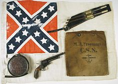 Extremely rare Confederate 2nd national flag w/Madaus authentication letter, Confed. drummers strap and drumsticks from Co. B, 5th Inf. Reg., outstanding carved wooden Confed. canteen captured at Fort Blakely, AL, fine rare LeMat pistol, extremely rare Confed. ditty bag from Chief Engineer Miles Freeman of the C.S.N. Alabama.