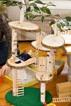 Handmade Mini Treehouse - the discs of wood were bought at a hobby/craft store