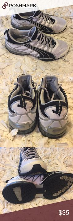 Men's black white Puma tennis shoes Perfect condition. Only signs of wear on soles, and that is very minimal. Only worn a few times. Black, white and silver design. Men's size 10. Puma Shoes Sneakers