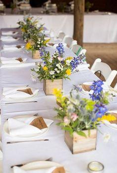 wildflowers and wooden box wedding centerpiece / http://www.himisspuff.com/boho-rustic-wildflower-wedding-ideas/10/