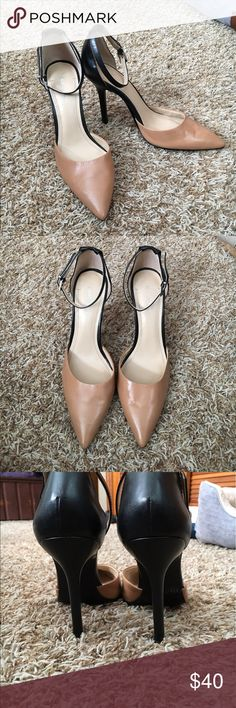 BCBGeneration 4inch Heels Tan and black 4 inch heels with a strap around them.These shoes are in great condition BCBGeneration Shoes Heels